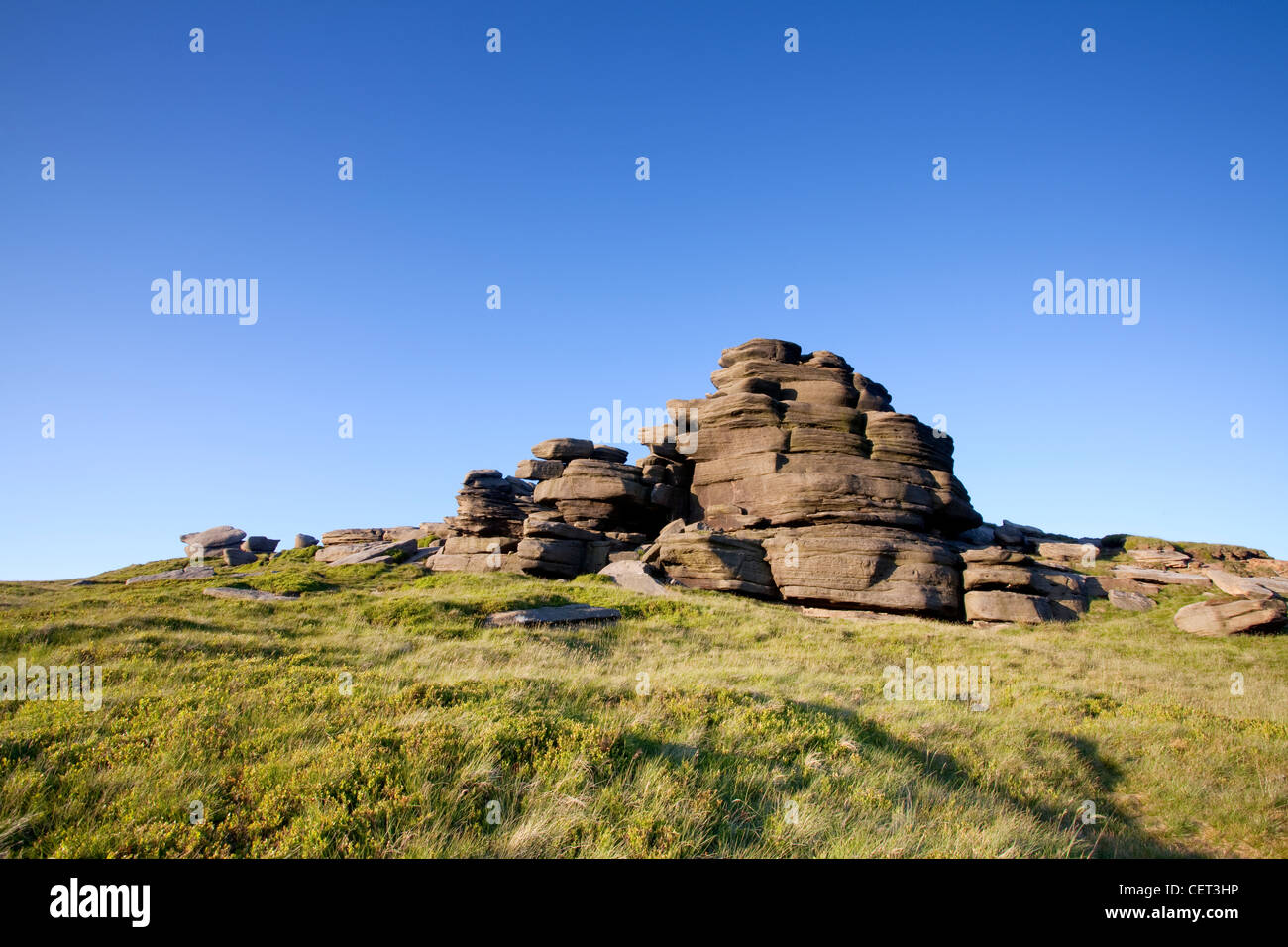 Rock formations on Kinder Scout, a moorland plateau and the highest point in the Peak District National Park. - Stock Image
