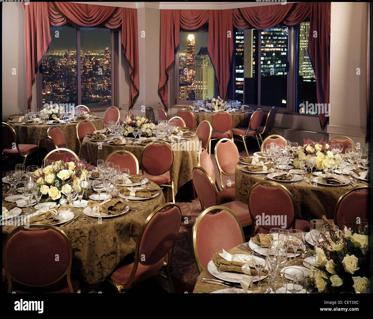 Dining room, ready for event, conference, wedding. In high rise with night city view with lights Stock Photo