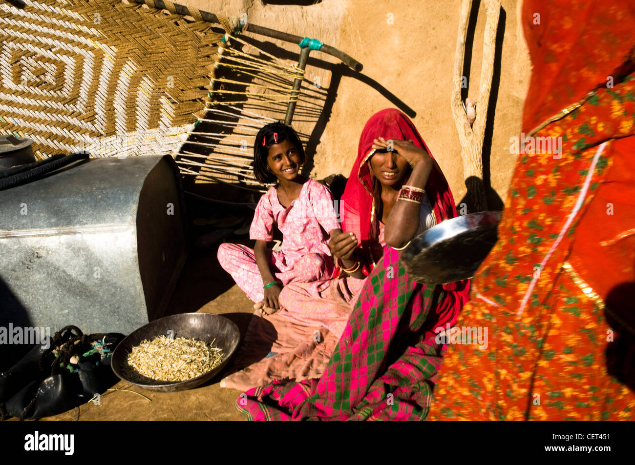 Charming Women Doing House Work In Their Village In Rajasthan, India.
