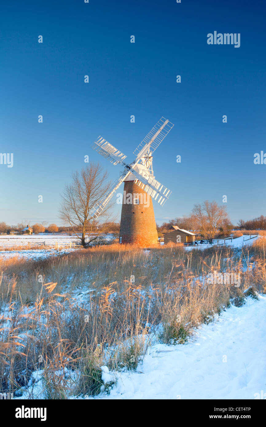 Snow on the ground around the newly restored Hardley Drainage Mill, originally built in 1874, on the Norfolk Broads. - Stock Image