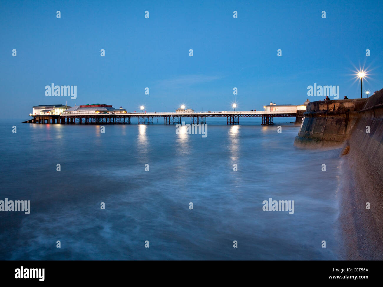 Cromer Pier, home to the Cromer Lifeboat Station and the Pavilion Theatre, on the Norfolk coast at dusk. - Stock Image