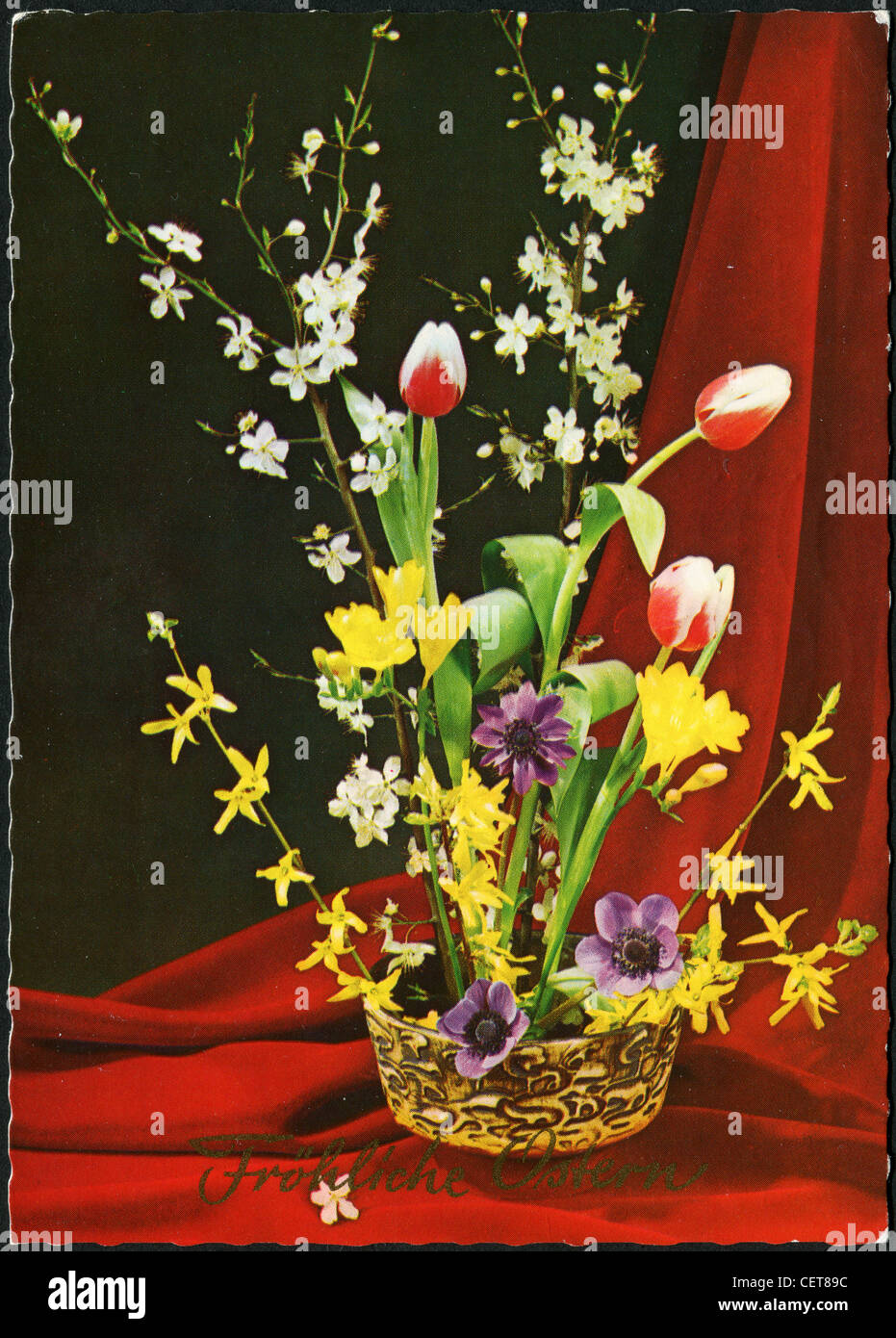 Easter postcard printed in Germany, shows the beautiful flowers in a vase, circa 1999. German Text: Happy Easter! Stock Photo