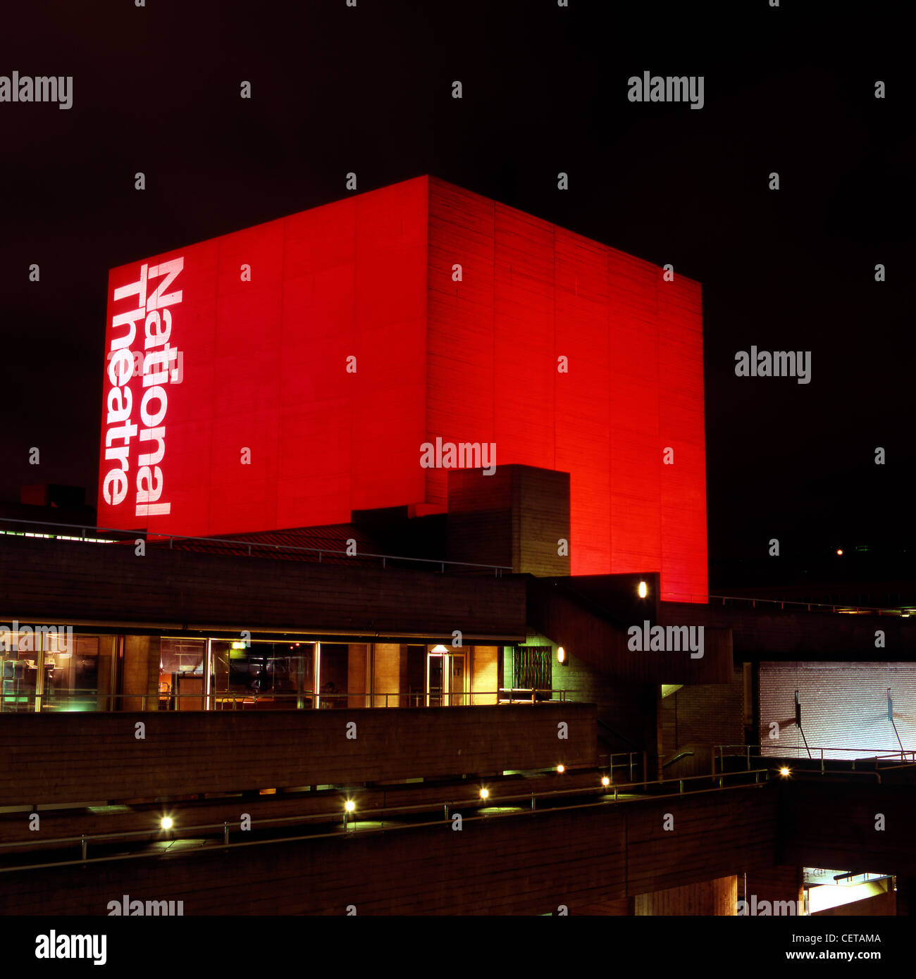The National Film Theatre Flytower illuminated red. - Stock Image