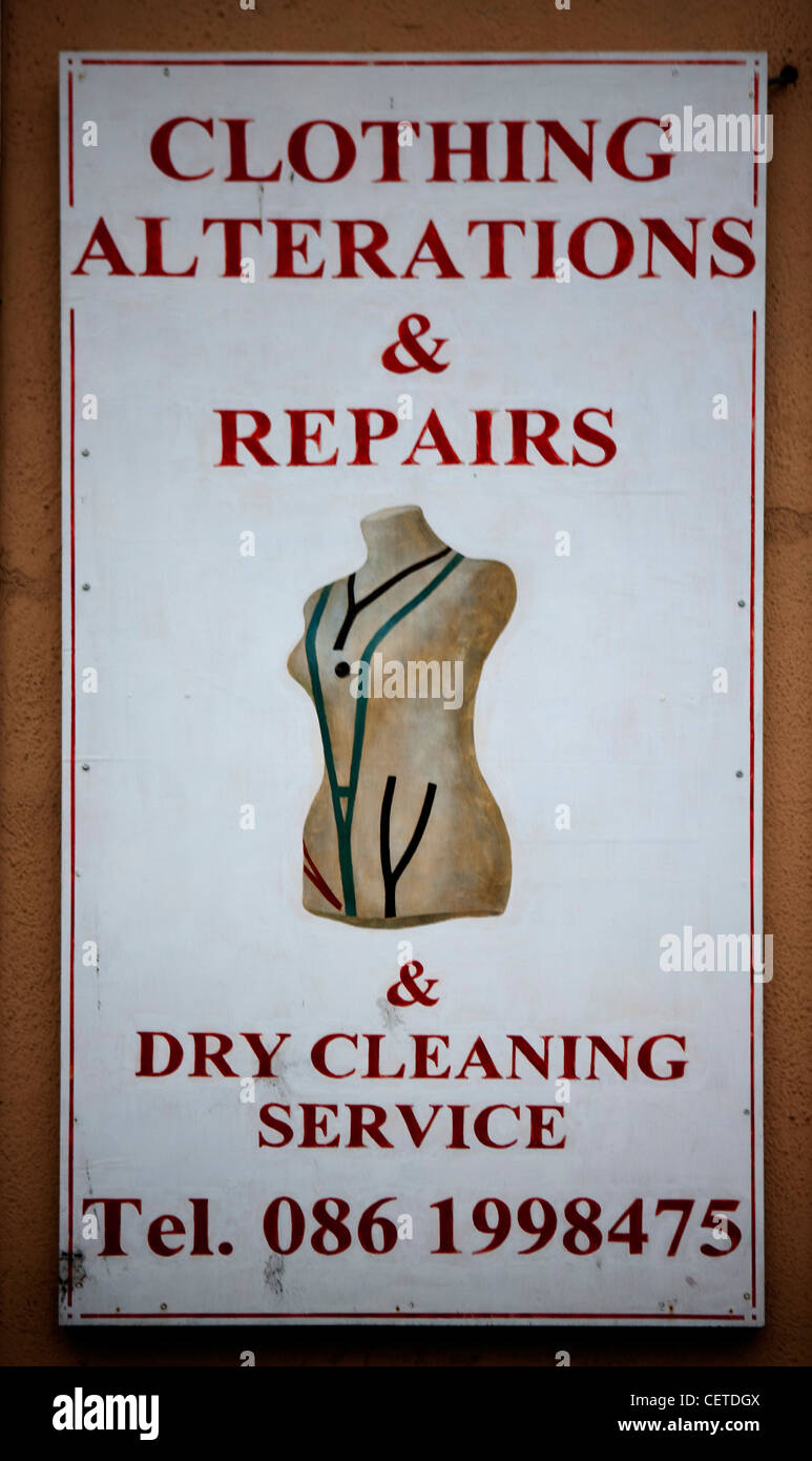 Clothing alterations & dry cleaning shop sign - Stock Image