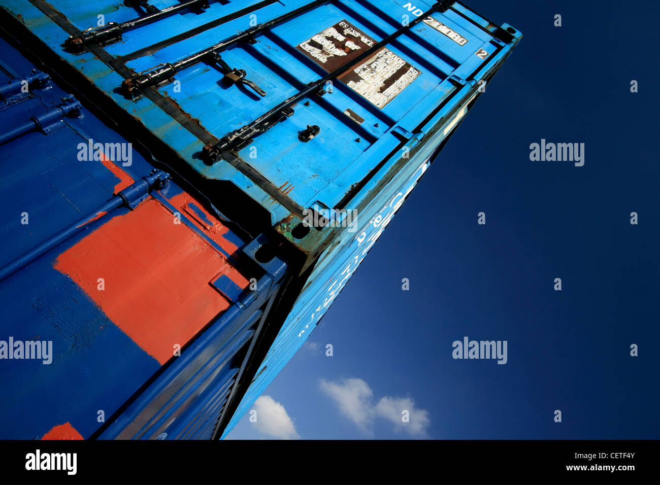 An angled view of blue steel containers stacked at Goole. - Stock Image