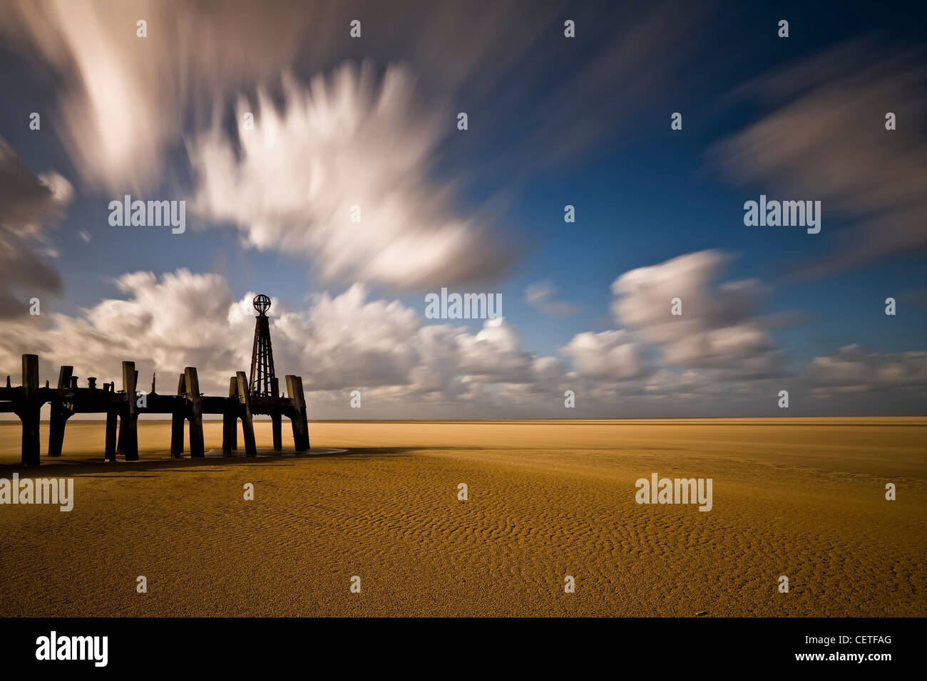 The end of an old wooden jetty at Lytham Saint Annes beach. - Stock Image