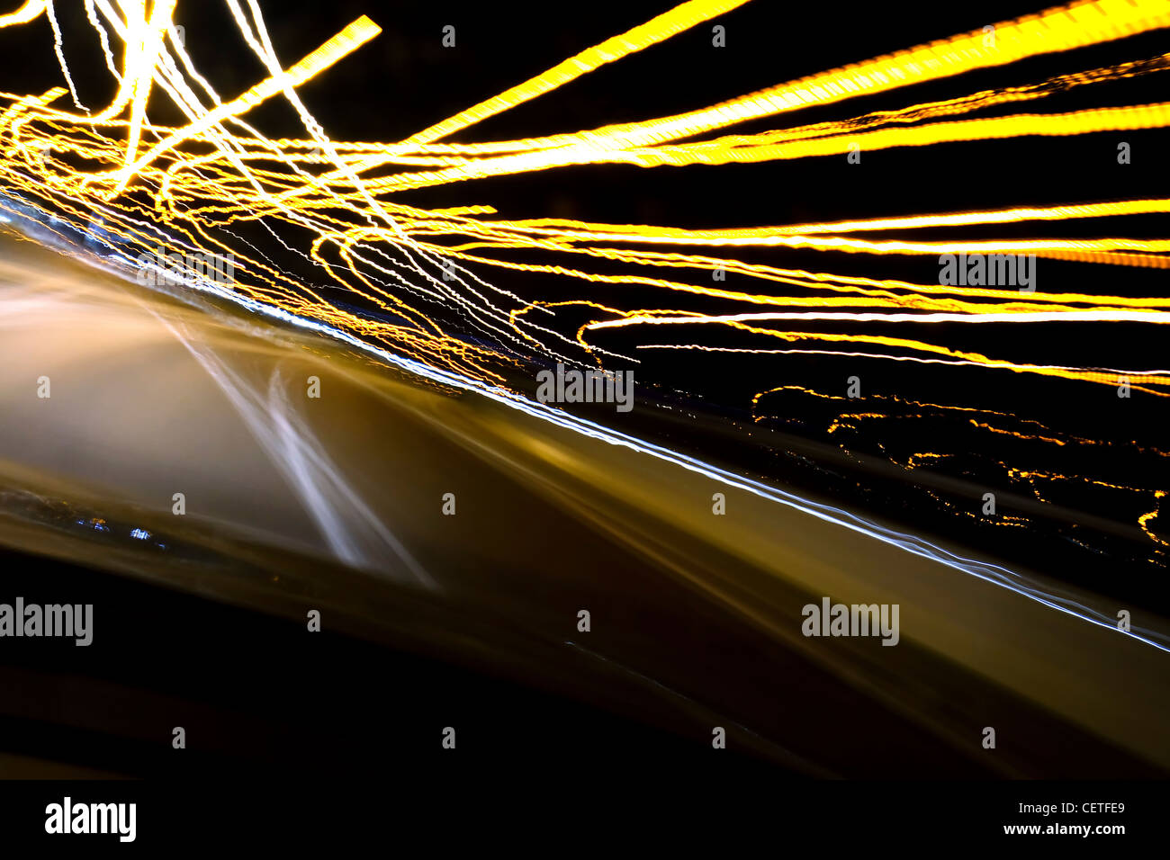 A view from a moving car to light trails on the M1 motorway at night. - Stock Image
