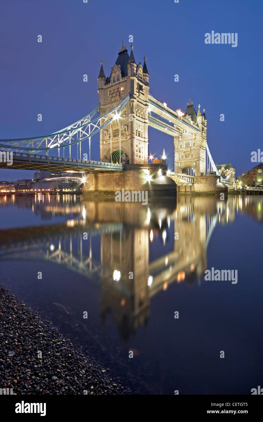 Tower Bridge at night. Completed in 1894, it took eight years, five major contractors and the relentless labour - Stock Image