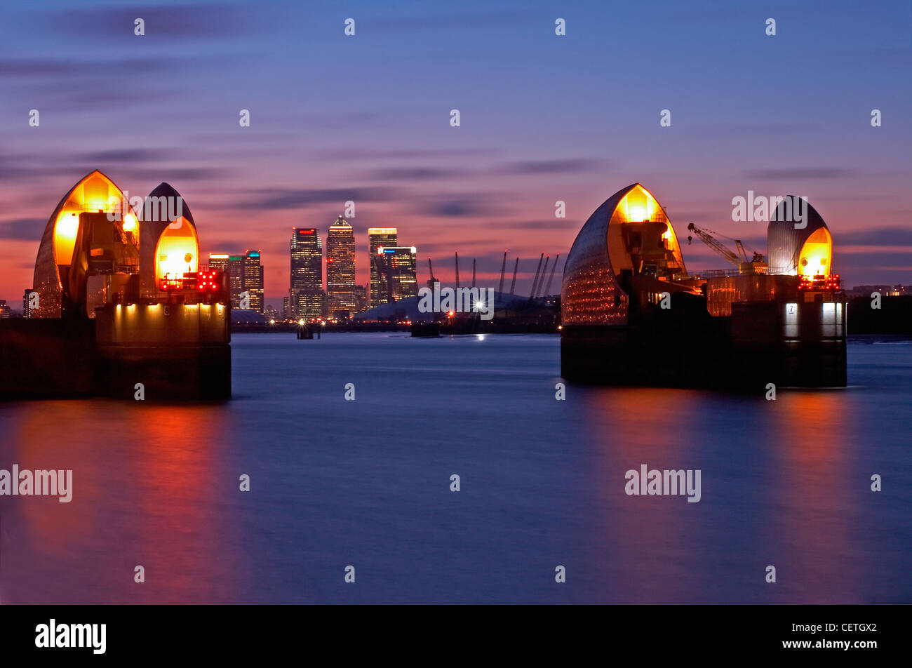 Thames Barrier at dusk. Built in 1984 as London's flood defence, the 1716 feet width of the river is divided - Stock Image