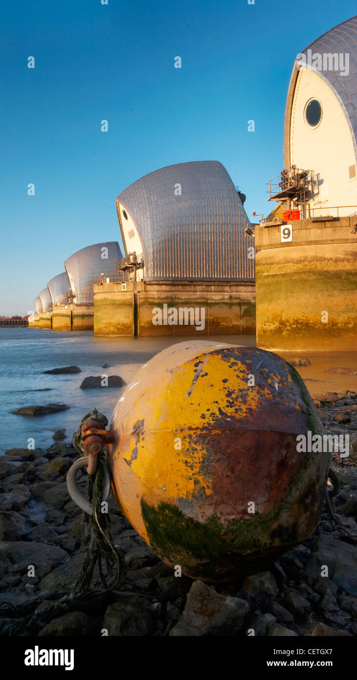 Thames Barrier at sunset. Built in 1984 as London's flood defence, the 1716 feet width of the river is divided - Stock Image