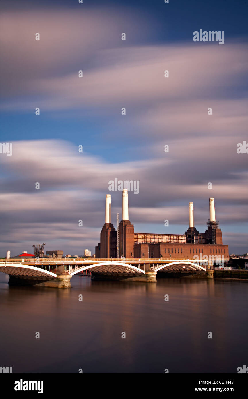 A view over the Thames to Battersea Power Station. Sir Giles Gilbert Scott was commissioned to design the building - Stock Image