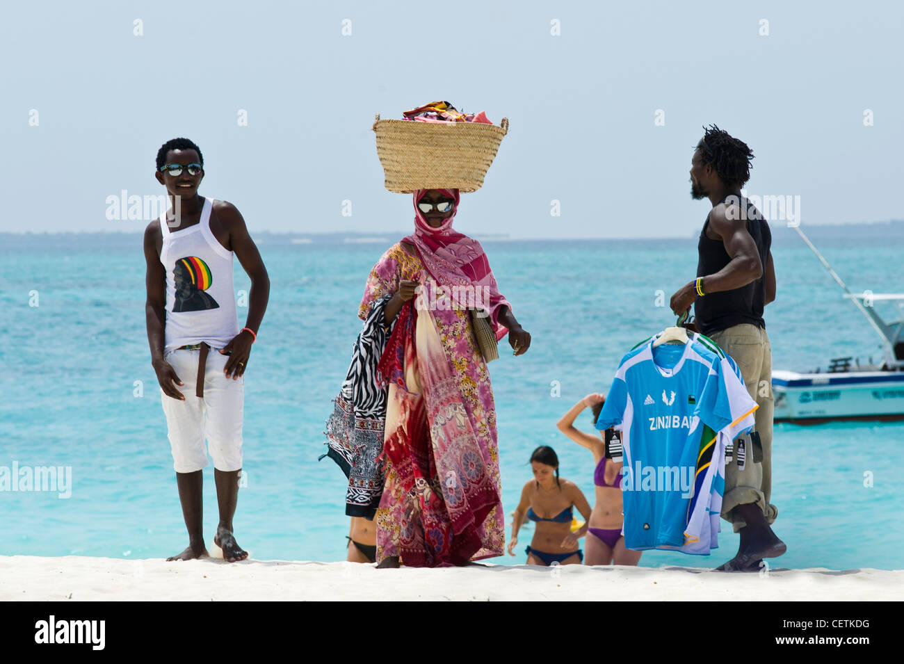 Salesmen on the beach of Kendwa Rocks north coast of Zanzibar - Stock Image