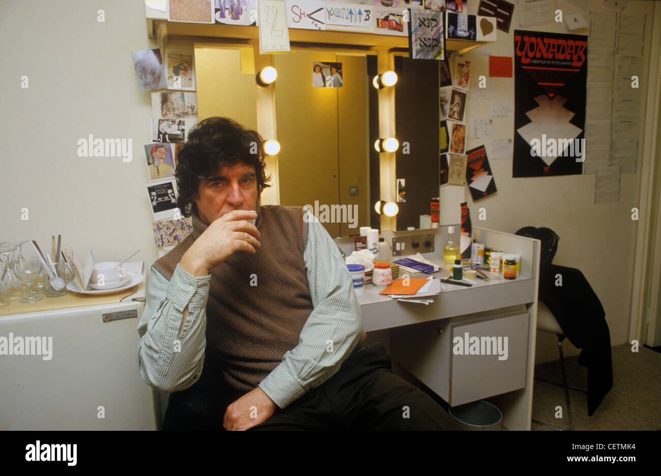 Alan Bates in dressing room National Theatre before staring in Yonadab by Peter Shaffer 1980s London UK. - Stock Image