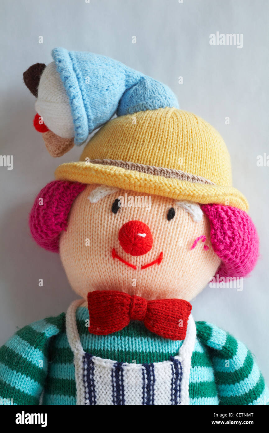 knitted toy with ice cream cone on head set against white background - Stock Image