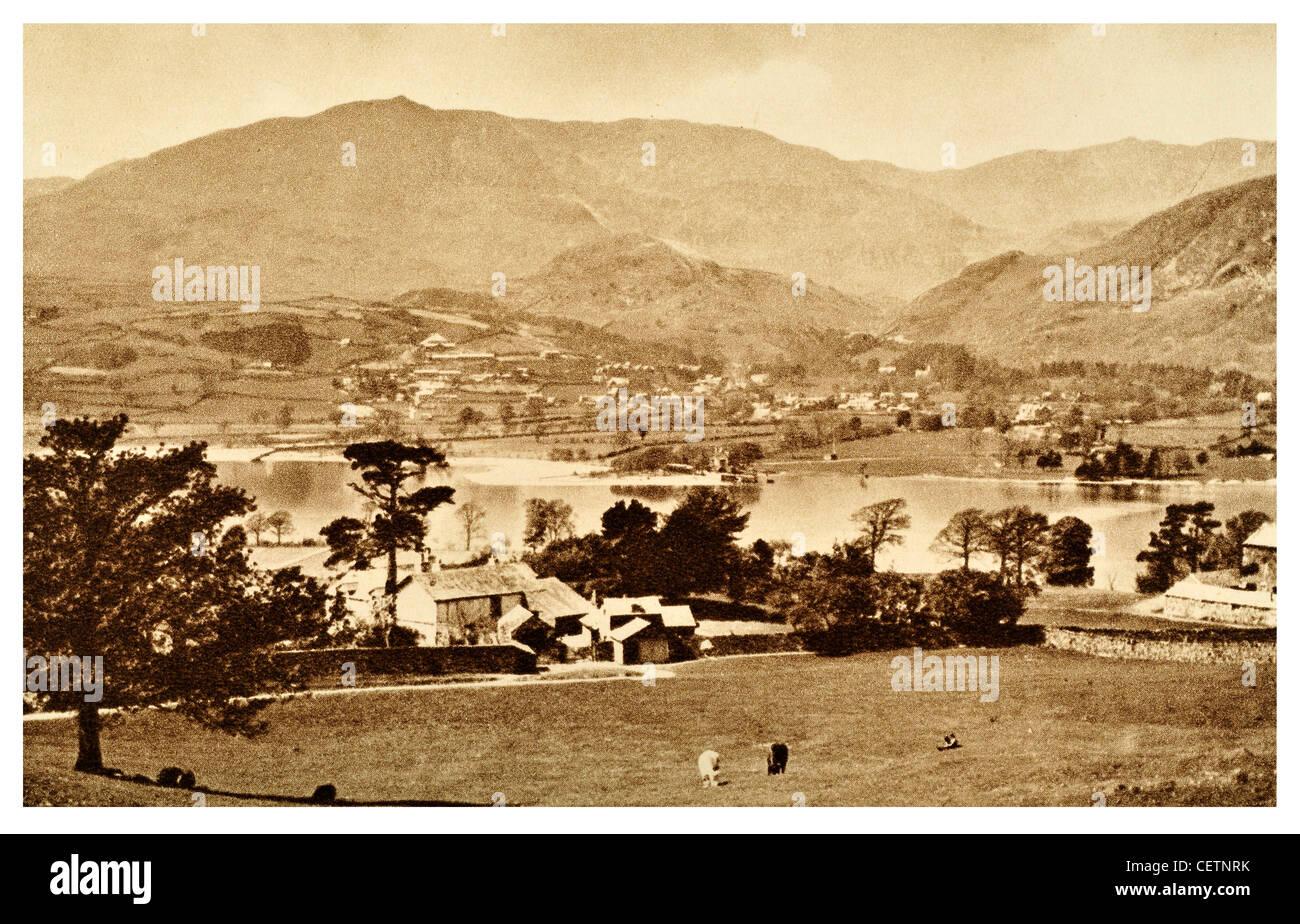 Coniston Lake and Village - Stock Image