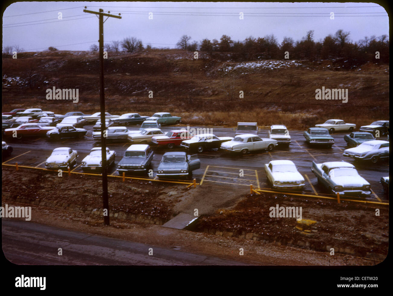 Cars parked in parking lot at Fort Wolters, Texas helicopter pilot training school during Vietnam War. 1965 mineral Stock Photo