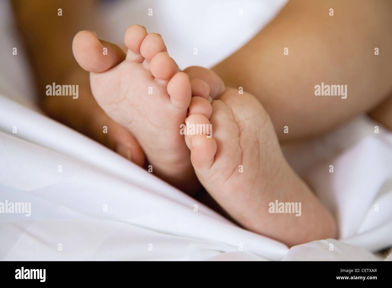 Baby's bare feet Stock Photo