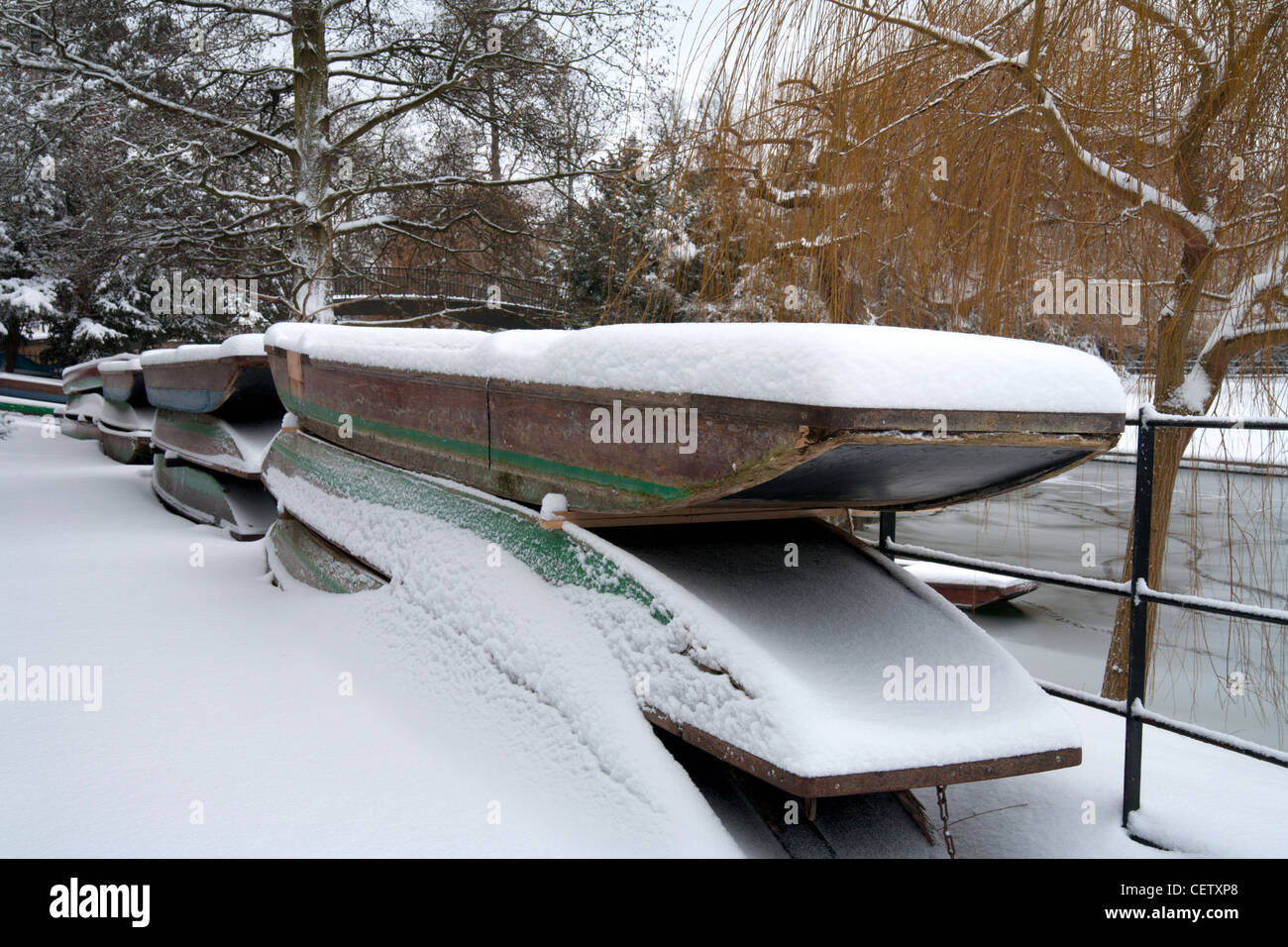 Punts out for the winter, Trinity College, Cambridge snow - Stock Image