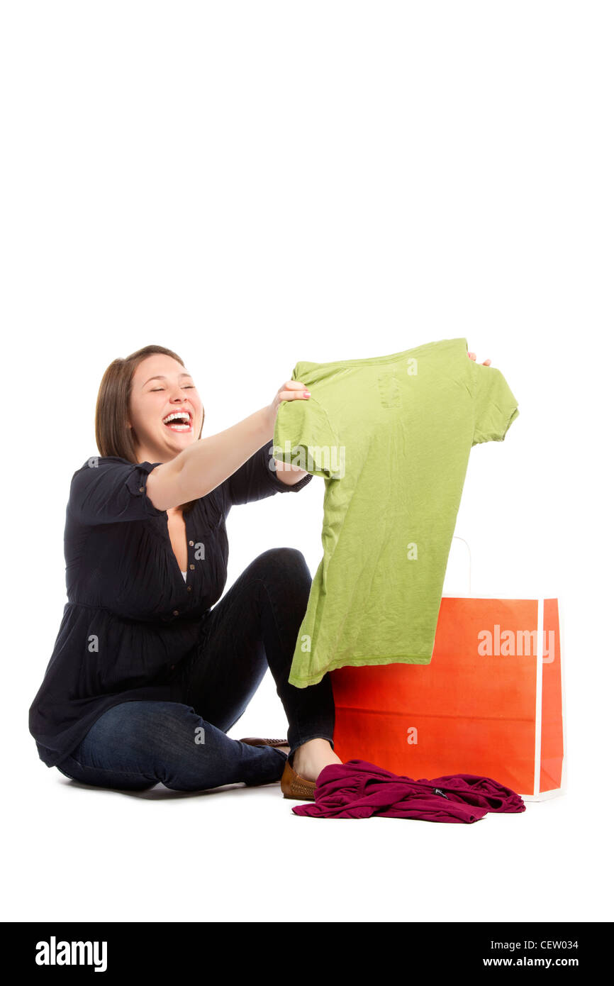 Portrait images of shopaholic young woman happy with the discounted rates - Stock Image