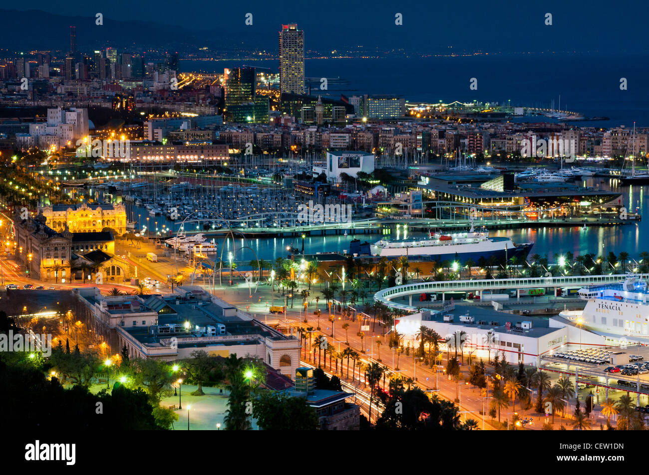 Panoramic view at night from Montjuic over Port Vell, Barcelona, Catalonia, Spain - Stock Image