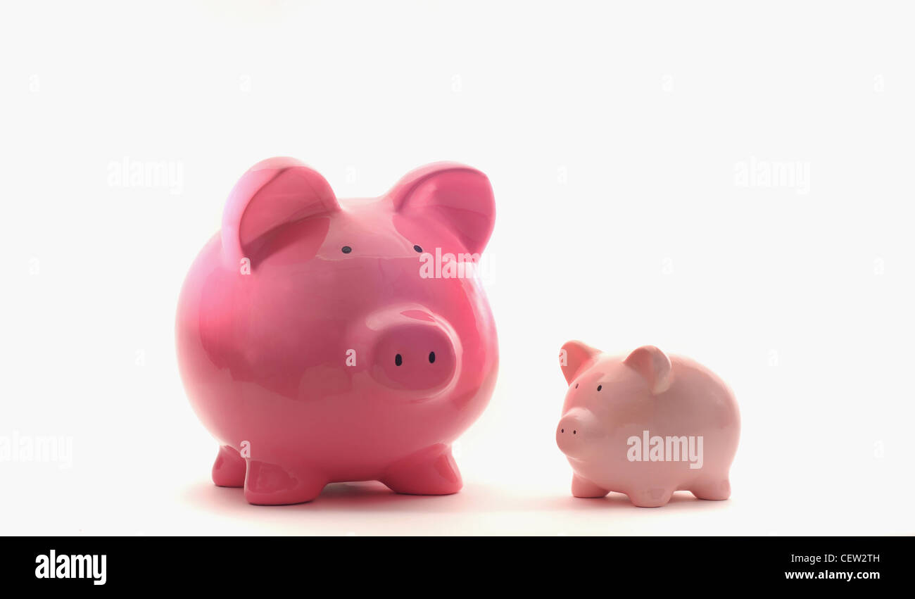 LARGE AND SMALL PIGGYBANKS RE FINANCIAL GROWTH SAVINGS THE ECONOMY BUDGETS LOANS CREDIT MONEY CASH INCOMES BANKS Stock Photo