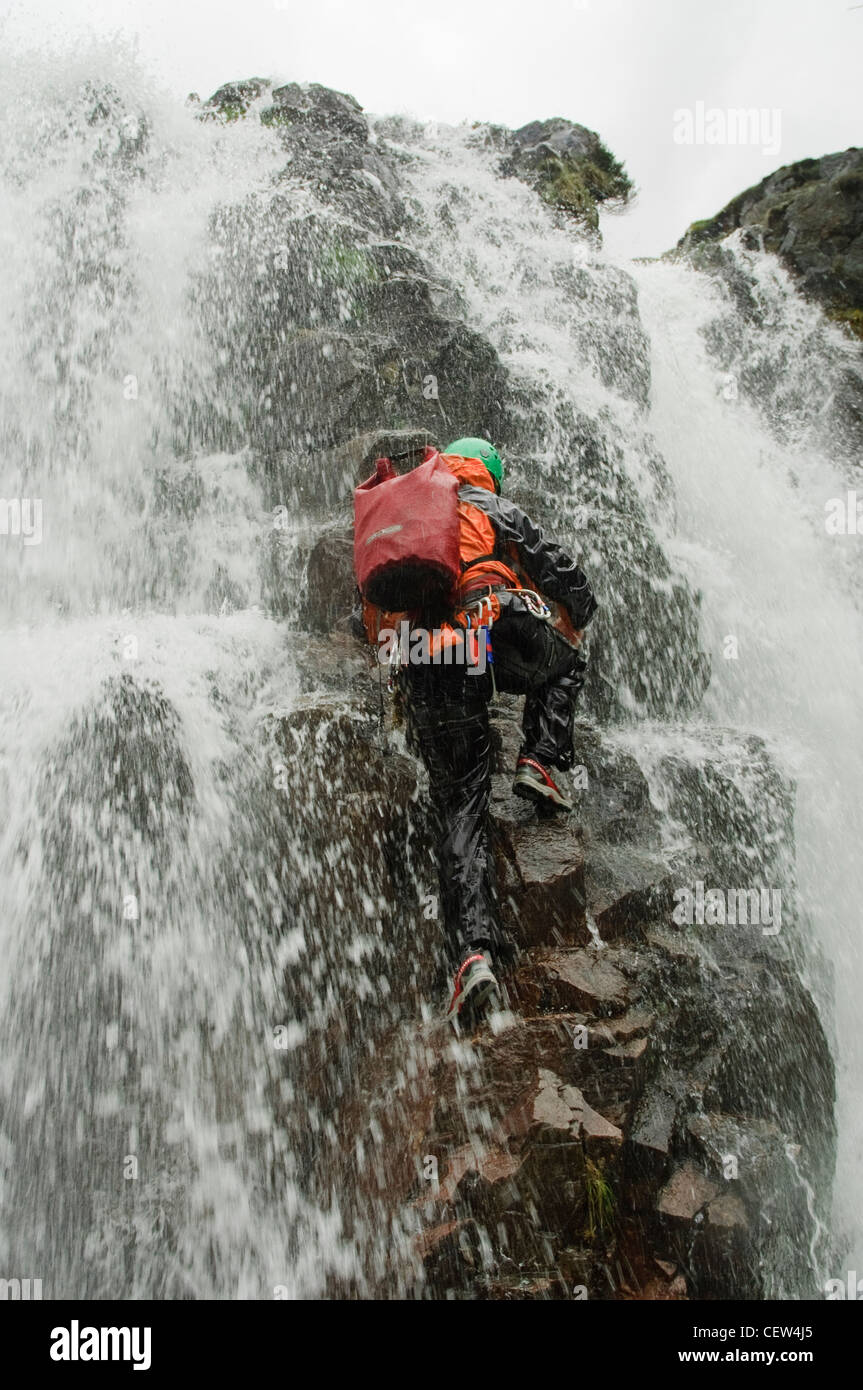 Climbing a waterfall in Stickle Gill, Great Langdale, Lake District - Stock Image