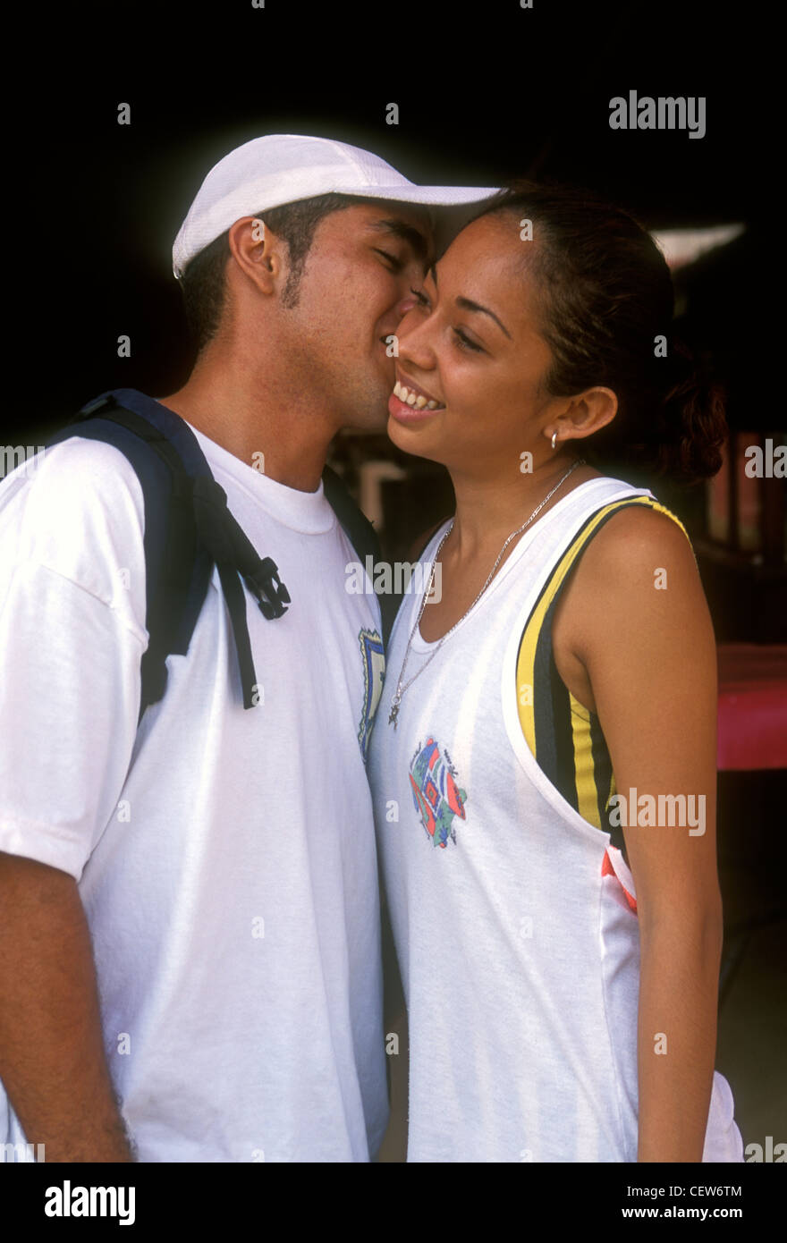 Mexicans greeting stock photos mexicans greeting stock images alamy mexicans mexican man mexican woman friends greeting kiss on cheek m4hsunfo