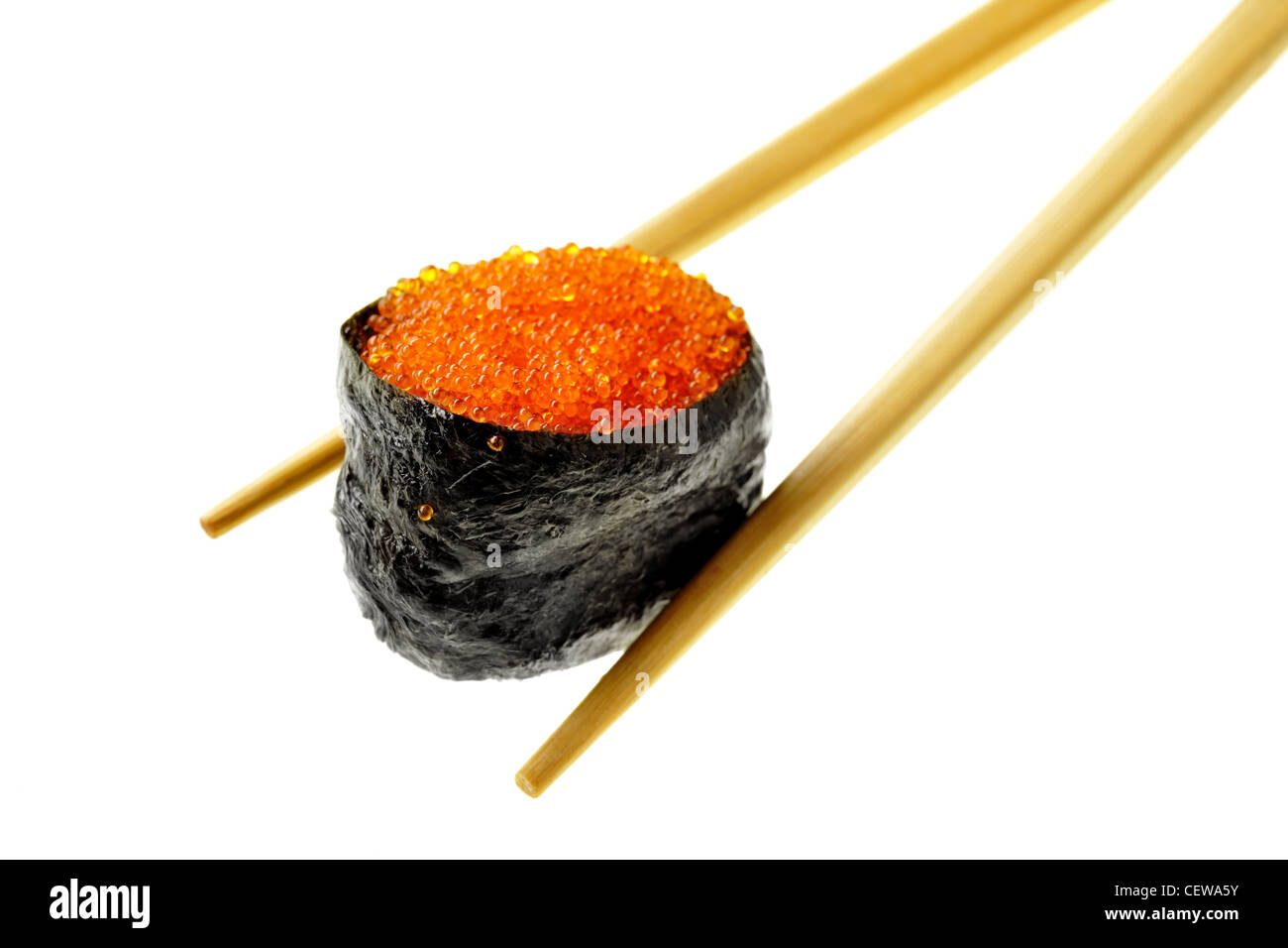 Sushi with fying fish caviar isolated over white background - Stock Image