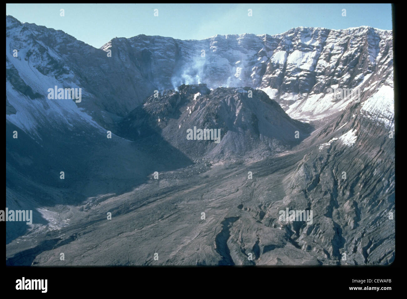 Since December 1980, eruptions of Mount St. Helens have added material to a dacitic lava dome with the crater, as - Stock Image