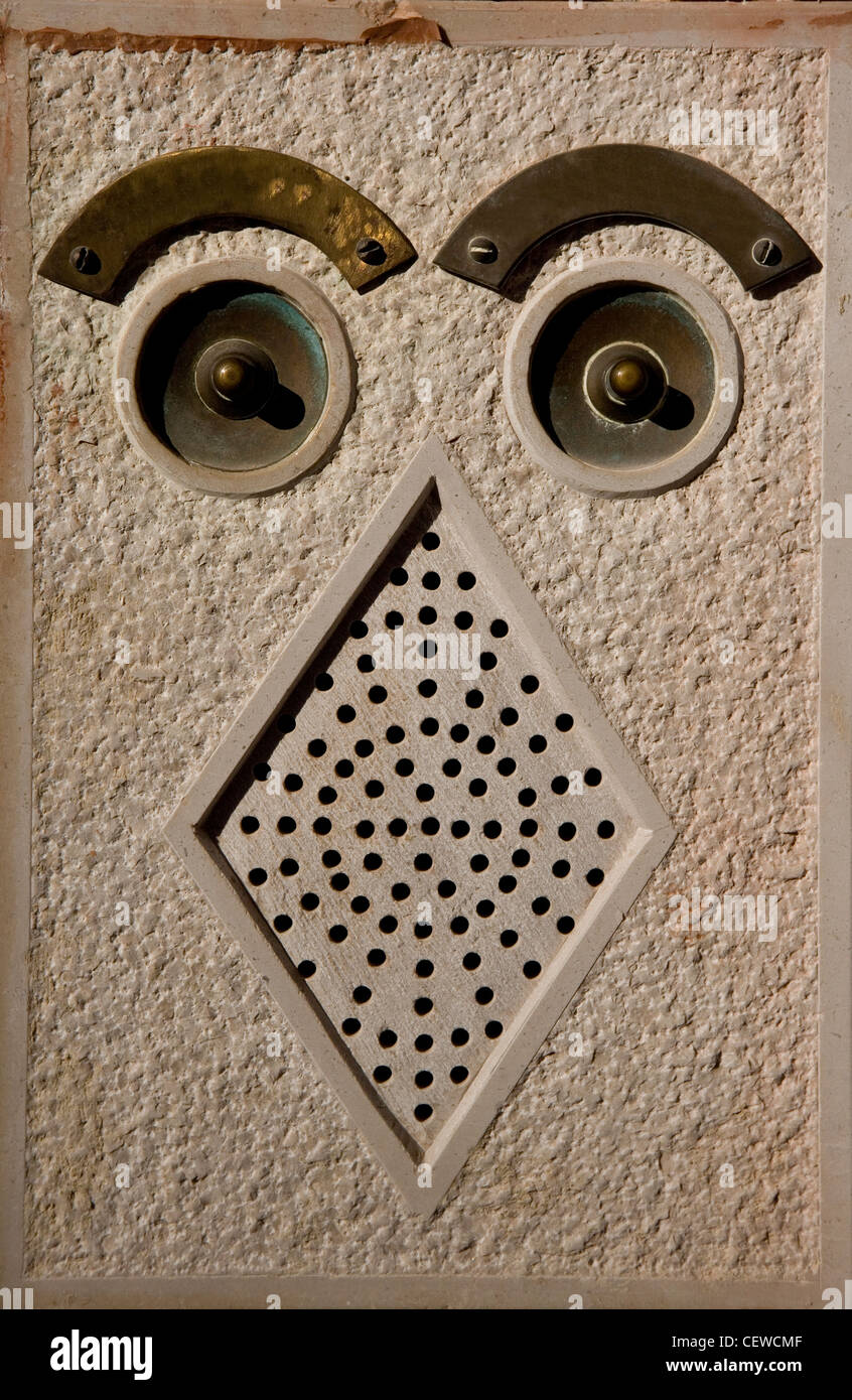 Door bell abstract looking like an owl - Stock Image