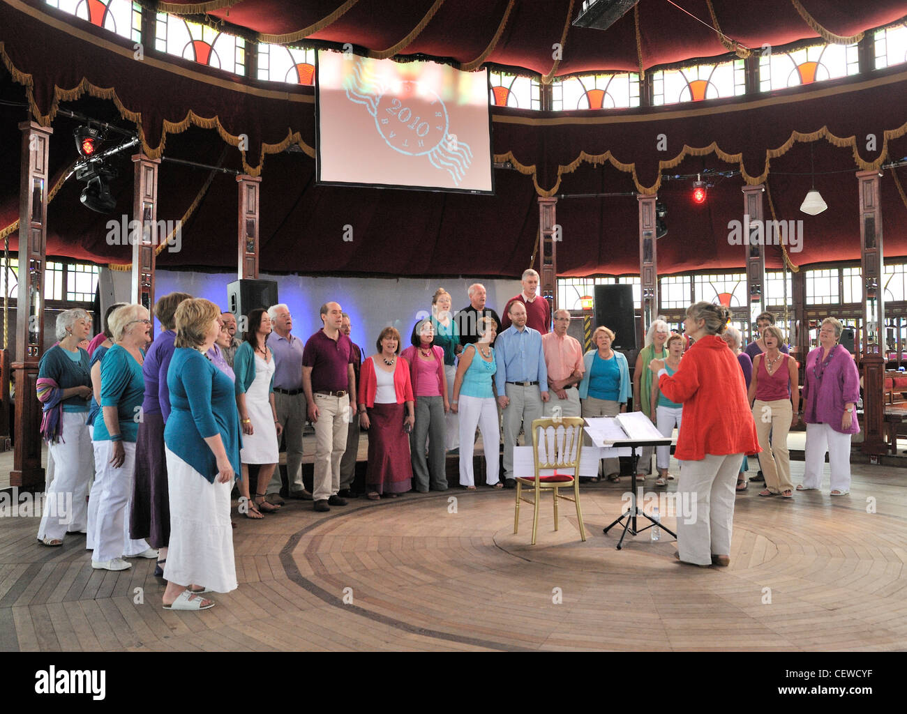 Sounding It Out Community Choir performing at the Bath Fringe Festival in the Spiegeltent Bath and Northeast Somerset - Stock Image