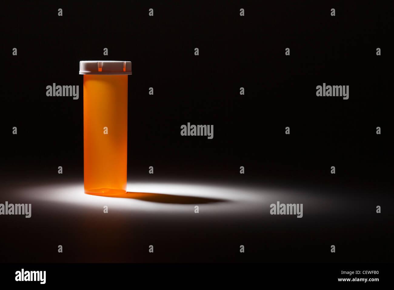 Empty Medicine Bottle Under Spot Light Abstract. - Stock Image