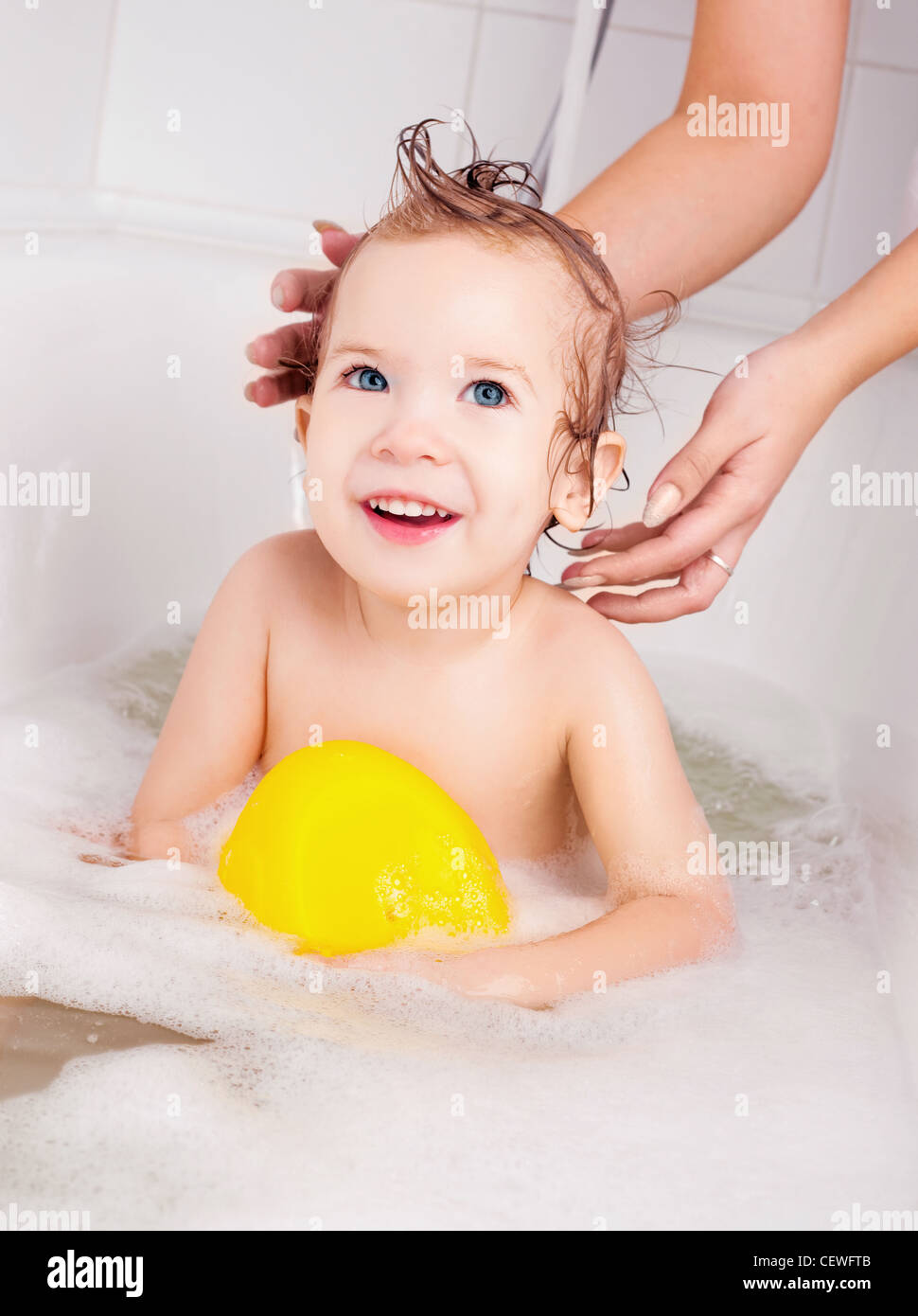 mother washing her baby in the bath with foam Stock Photo: 43587163 ...