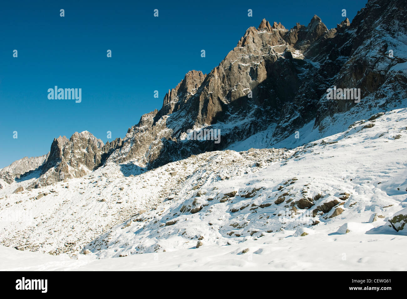 Snowy mountain peaks against clear sky - Stock Image