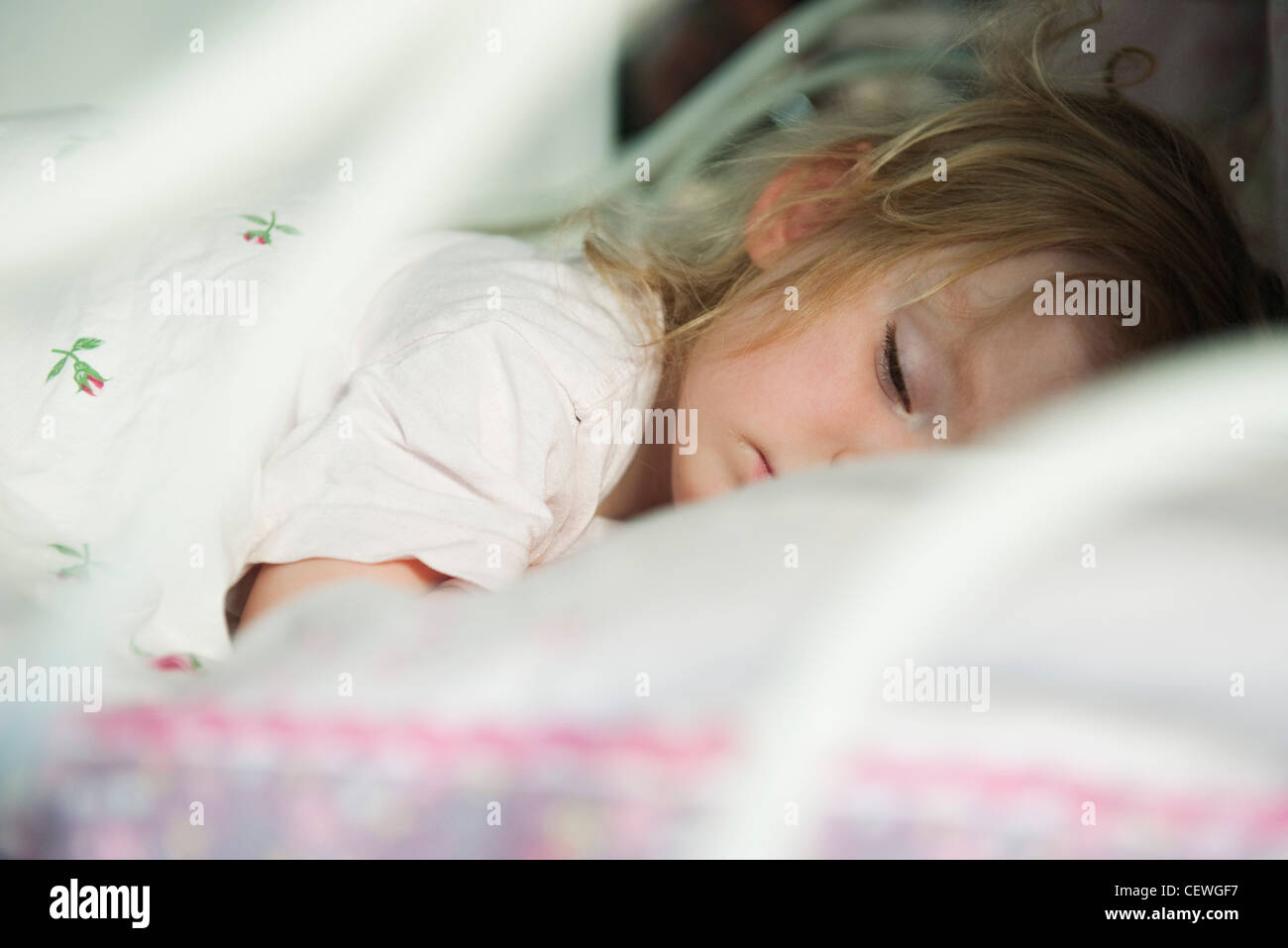 Toddler sleeping, obscured face - Stock Image