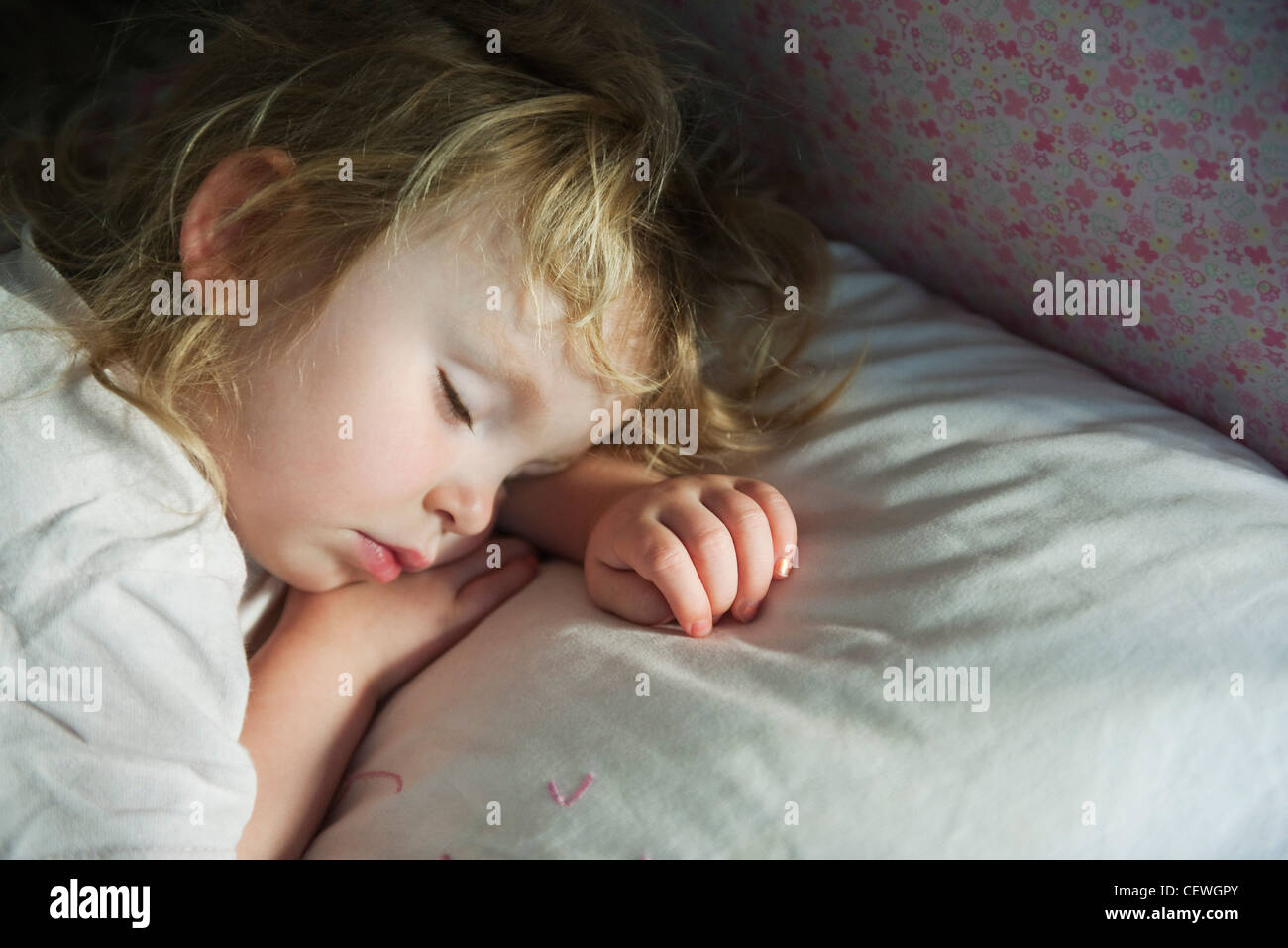 Toddler napping - Stock Image
