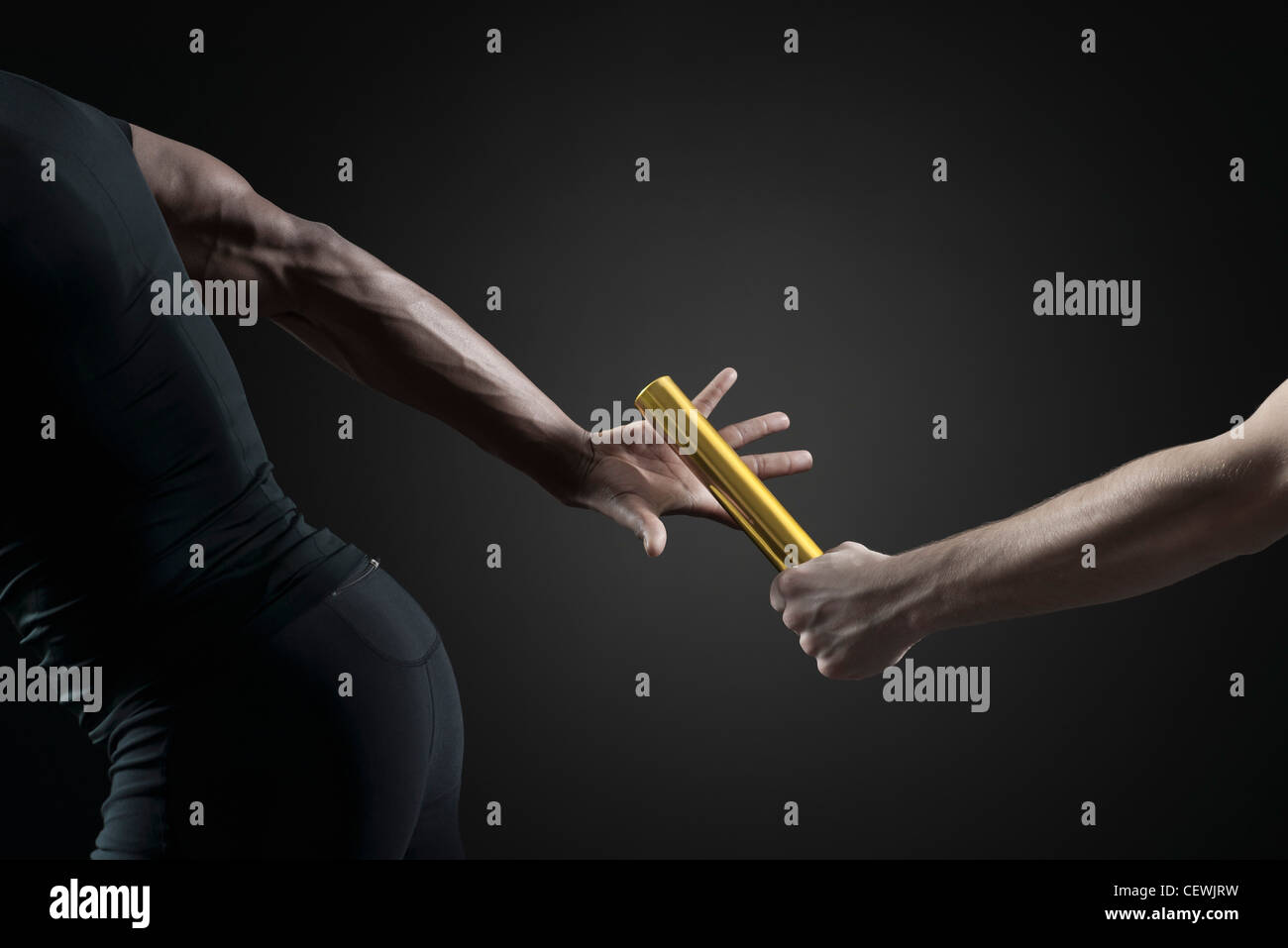 Runners passing baton, cropped - Stock Image
