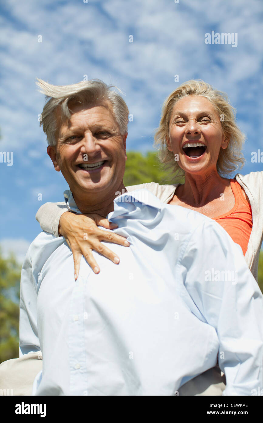 Mature couple together outdoors, portrait - Stock Image