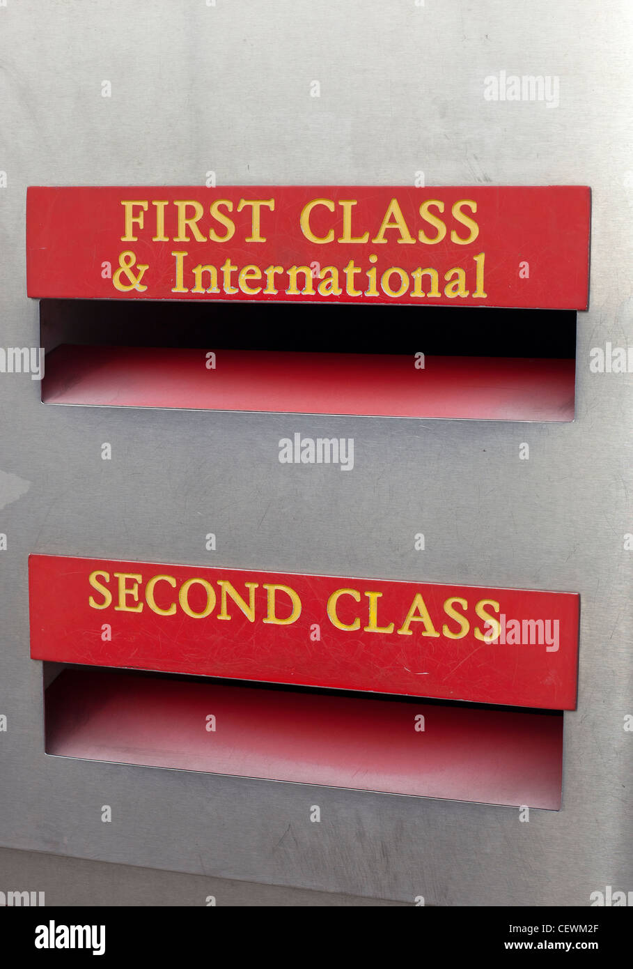 First Class and International and Second Class posting boxes close up. - Stock Image