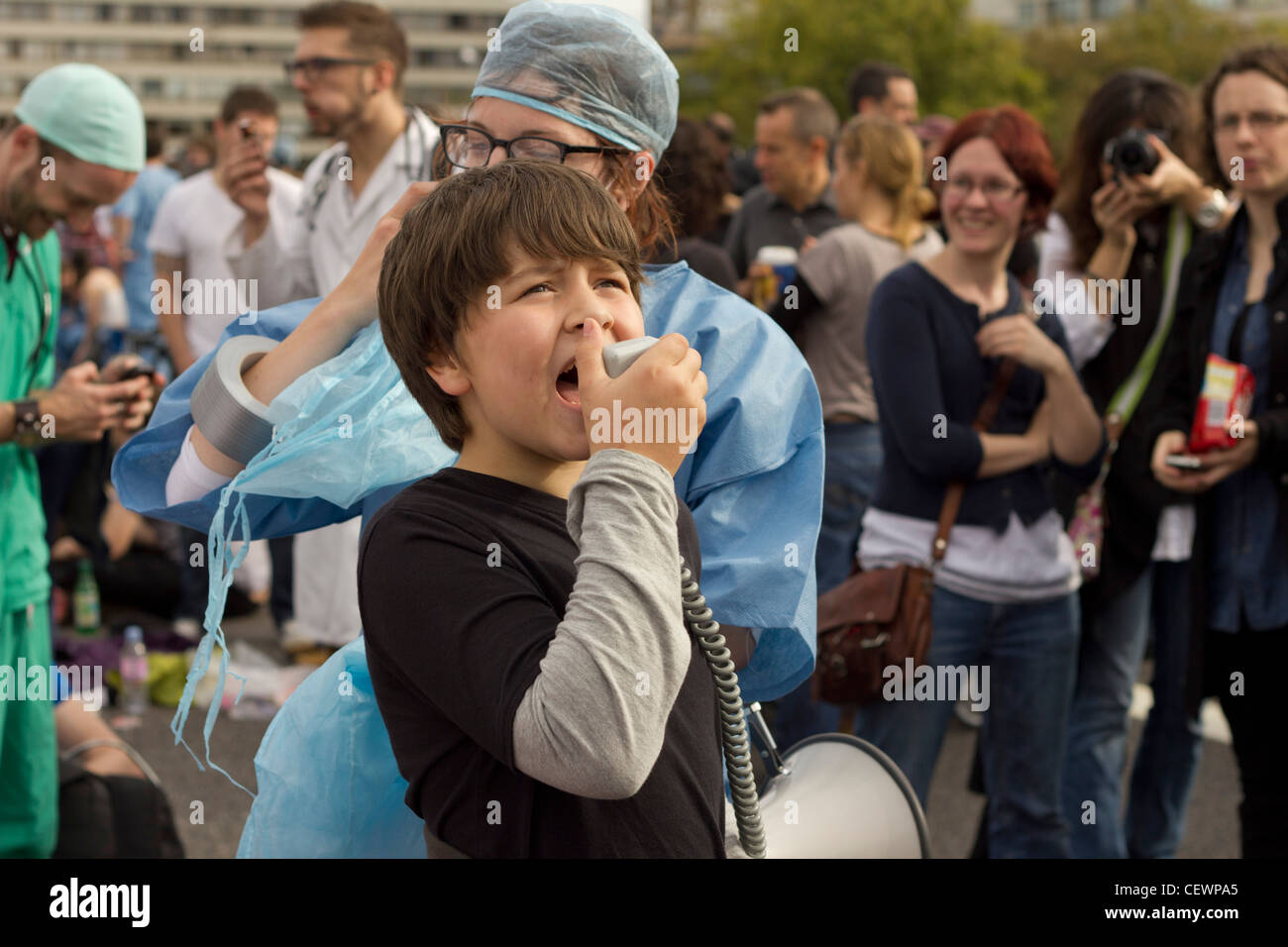 A young boy seen here shouting slogan against reforms to the National Health Service - Stock Image