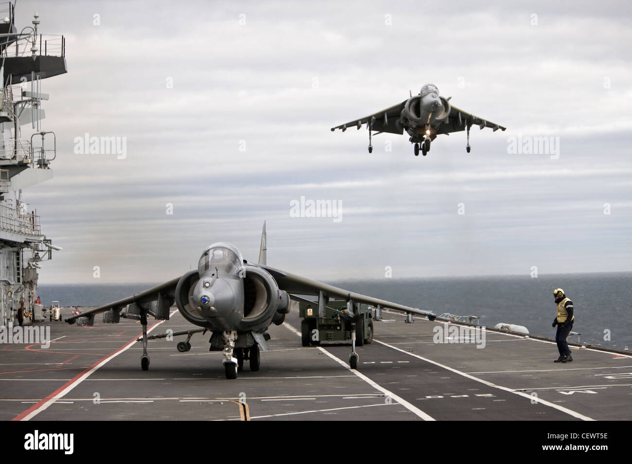 Harrier jet and crew on naval aircraft carrier HMS Illustrius - Stock Image