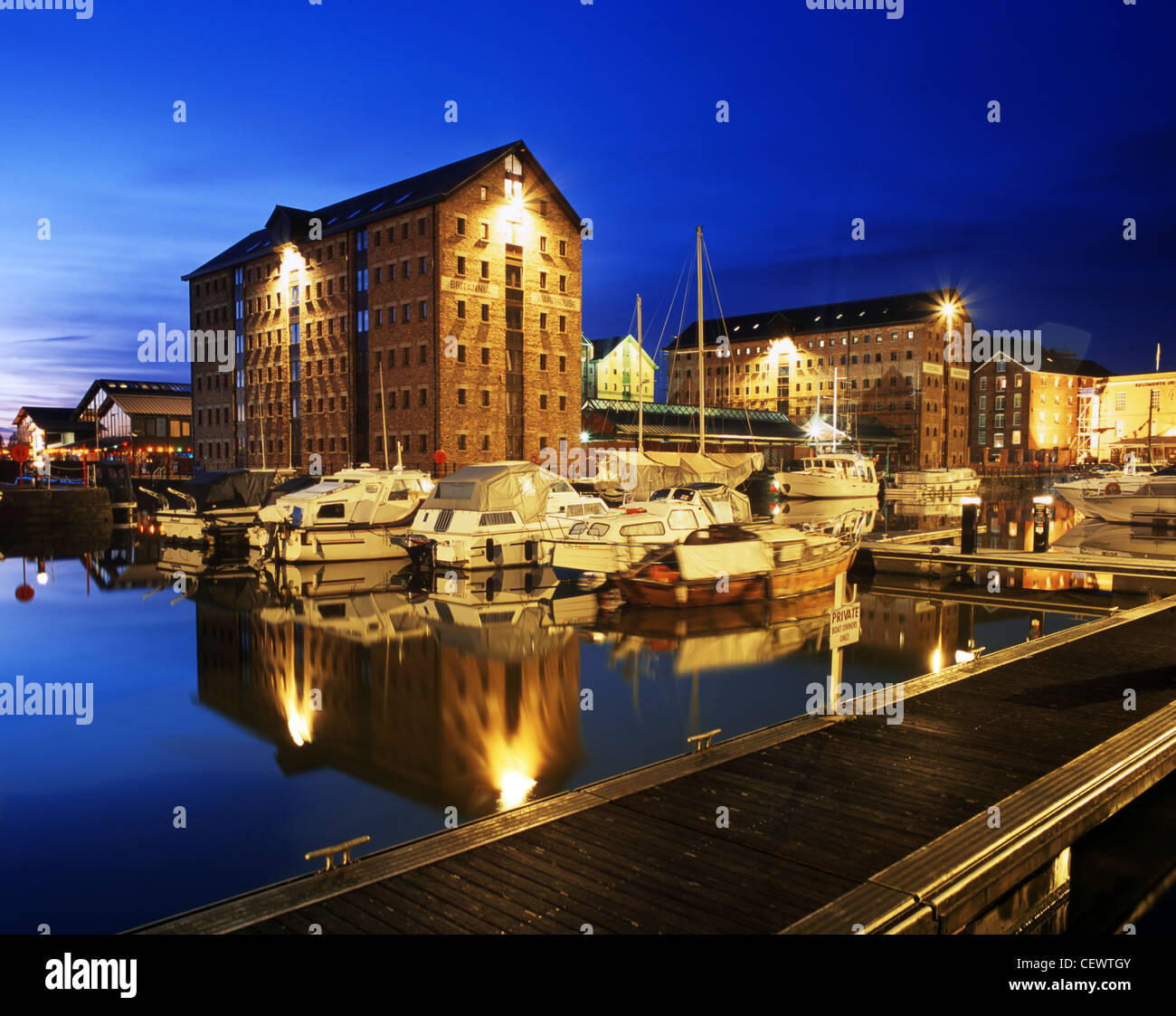 Victoria Dock, part of Gloucester Dock by night. The Britannia Warehouse (centre) is a modern replacement after - Stock Image