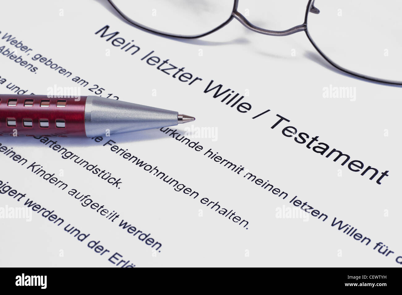 Detail photo of a testament, alongside are a pen and a glasses Stock Photo