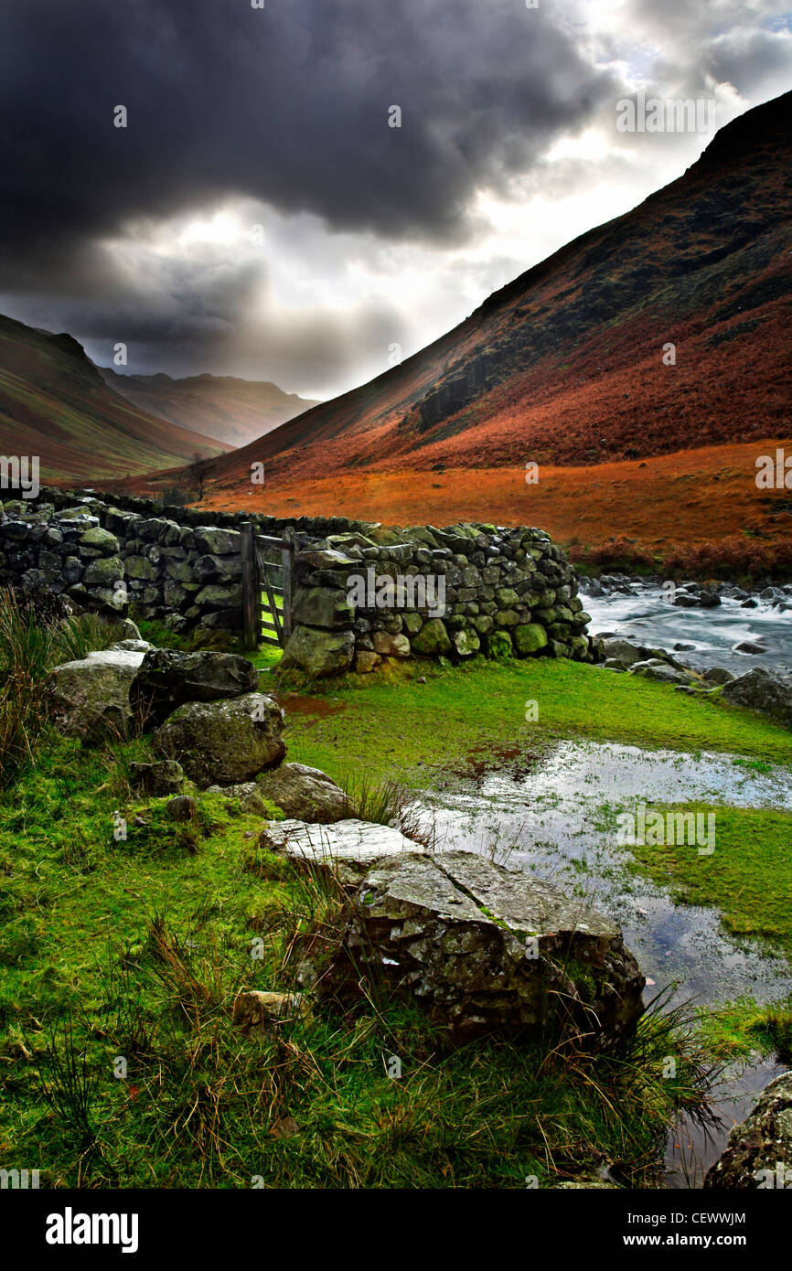 A view of the River Esk near Brotherilkeld. The River Esk begins in Great Moss below Scafell Pike in the English - Stock Image