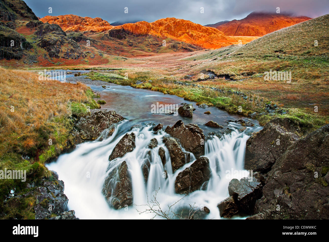 A view of the River Esk near Great Moss. The River Esk begins here below Scafell Pike in the English Lake District - Stock Image