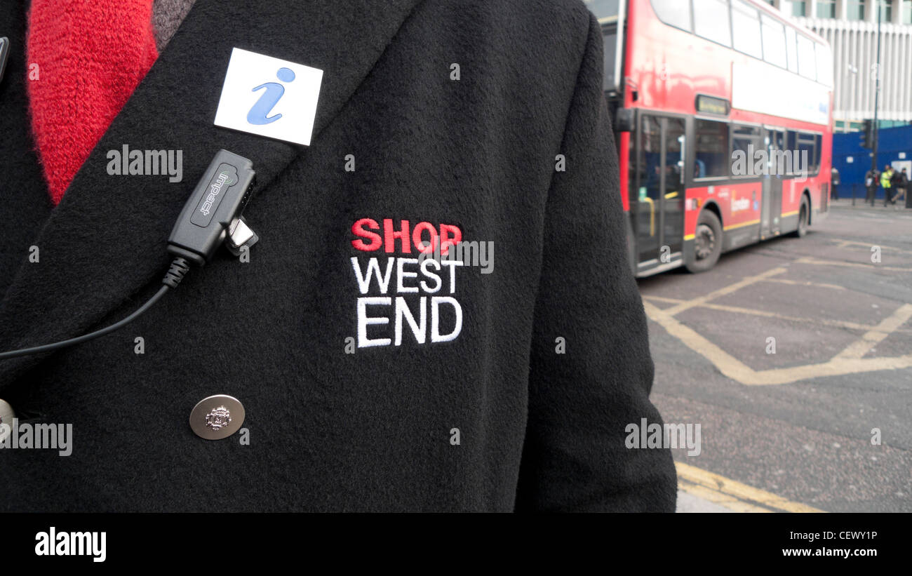 Close-up of Shop West End Information Officer emblem on employee's coat Tottenham Court Road and Oxford Street, - Stock Image
