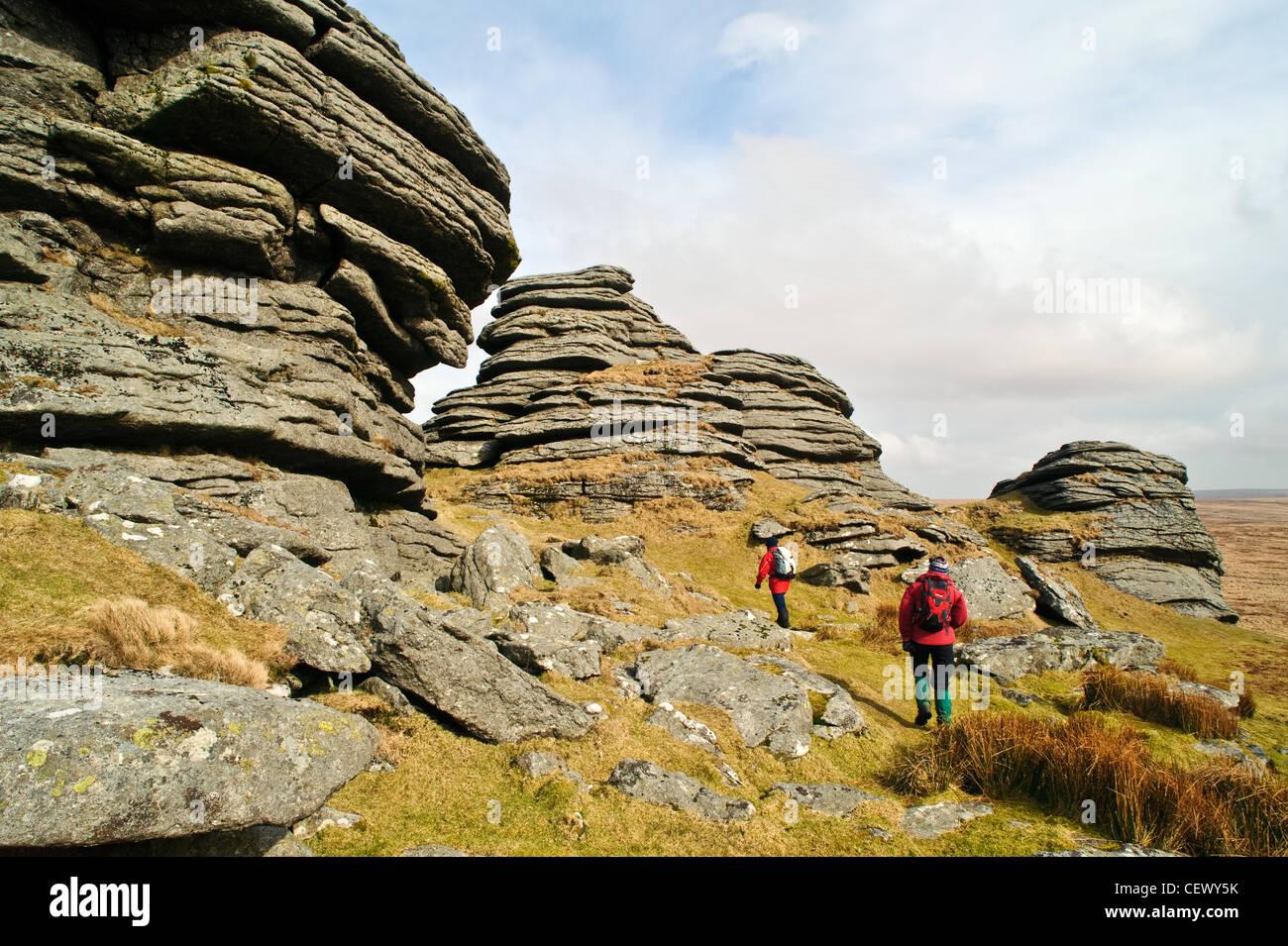 Walkers at Great Links Tor on Dartmoor, Devon - Stock Image