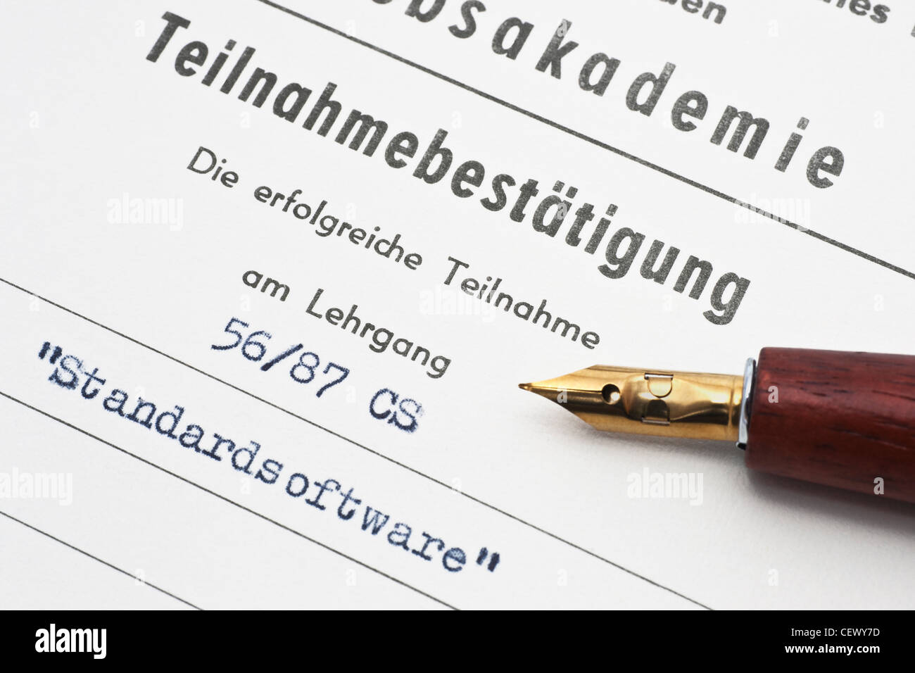Detail photo of a confirmation of participation in a standard software course, German language - Stock Image