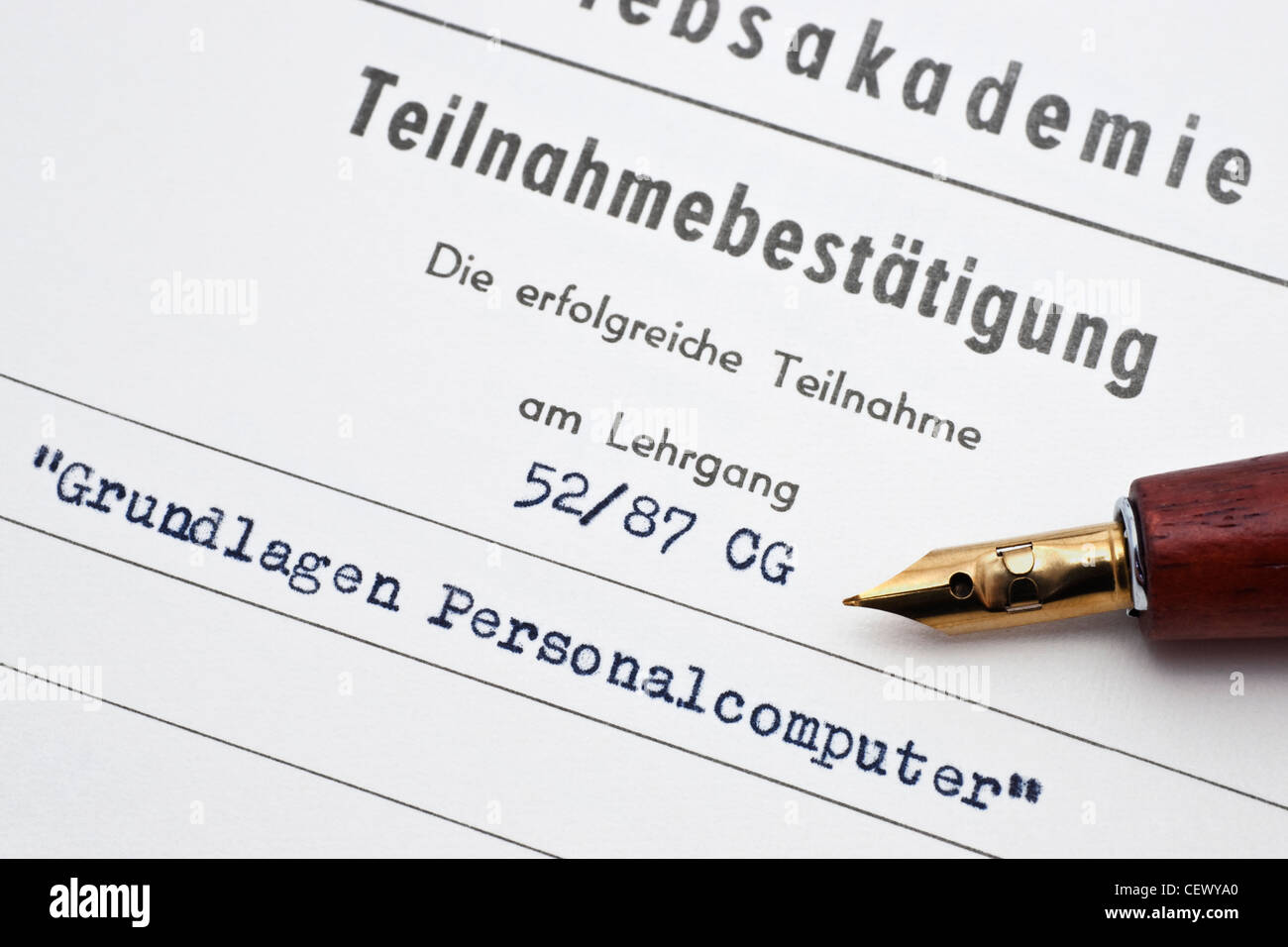 Detail photo of a confirmation of participation in a basic information course of personal computers, German language - Stock Image