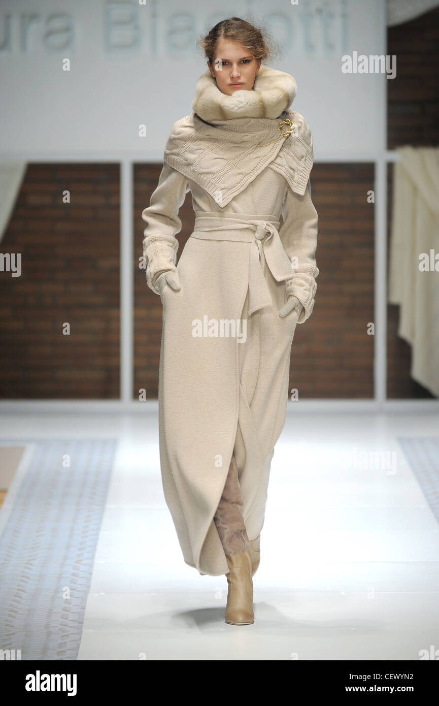 9f59c93650 Laura Biagiotti Milan Ready to Wear Autumn Winter Light brown outfit belted  long coat accessorized fur wrap and knit wrap knee